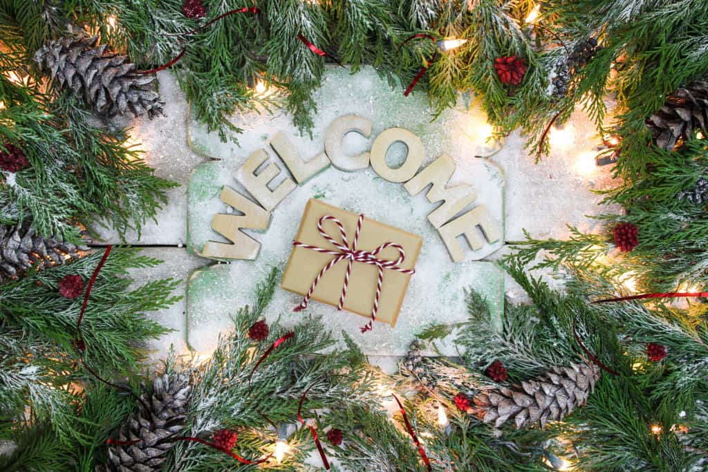 Holiday welcome sign with brown paper package