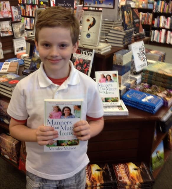 Corbett Holding Manners That Matter for Moms the Day the Book Debuted