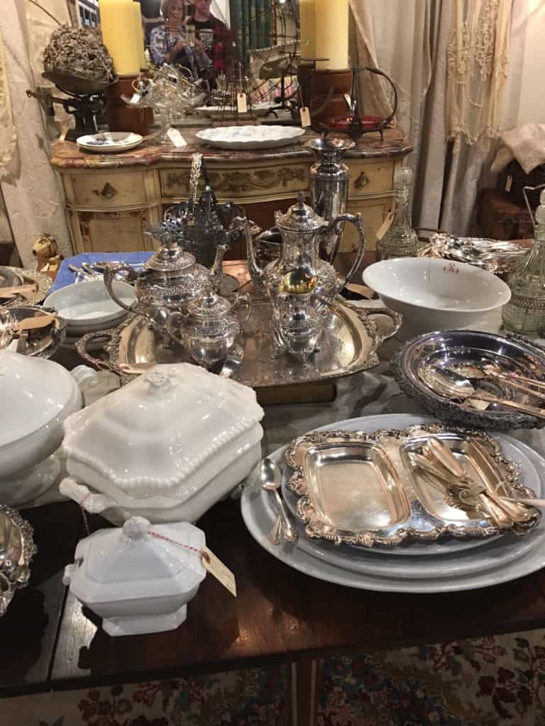 Marc, my oldest, home from his freshman year in college for Christmas break, actually wanted to go to the antique store with me this week after we saw a movie on a mother-son date. Was it wrong that I wanted everything on this table?! My heart has a soft spot for all things silver and for white china! However, I didn't buy a thing. Being with Marc was all that was needed to fill my heart. I love that boy!