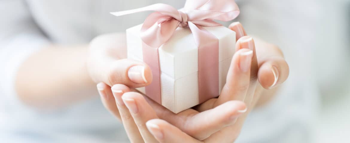 Do you know how to open gifts with grace and poise? Discover how the etiquette of gift giving to help you gracefully accept gifts from others.